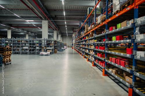 Obraz na plátně Rows of shelves with goods