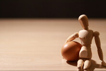 Wooden Puppet With Eggs On The Table