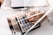 Bookkeeper Using Calculator Counting Finances Taxes Fees Accounting Calculate Bills Money Planning Budget Loan Payment Concept Pay Online On Computer Do Paperwork Work At Home Office Desk