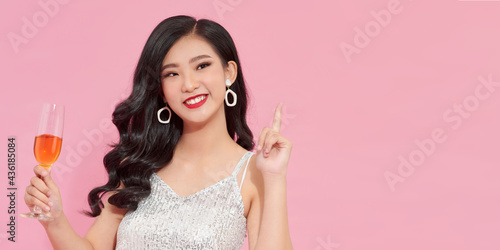 Canvastavla Young attractive woman in evening dress holding glass of champagne