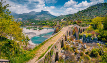 Attractive Spring View Of Old Mes Bridge. Majestic Morning Landscape Of Shkoder. Wonderful Outdoor Scene Of Albania, Europe. Traveling Concept Background.