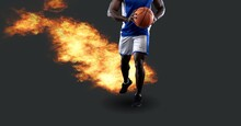 Composition Of African American Male Basketball Player Holding Ball With Fire And Copy Space