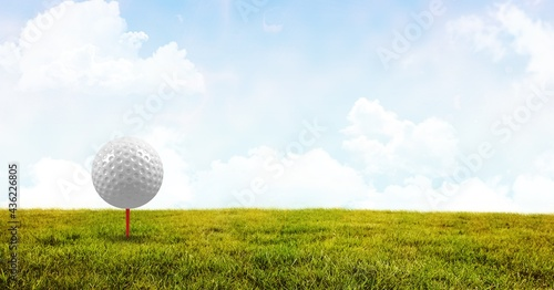 Fototapeta Composition of golf ball in grass on red tee and copy space