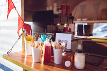 Close Up View Of Food Truck With Condiments And Red Bunting