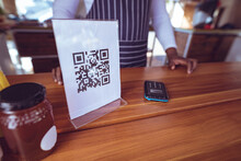 Midsection Of African American Man In Food Truck With Qr Code Menu On Worktop