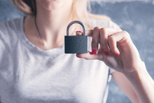 A Young Woman Holds The Lock