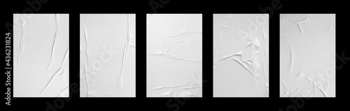 Fotografiet white crumpled and creased glued paper poster set isolated on black background