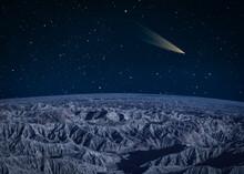Comet Passing Over A Barren Mountain Landscape