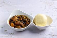 Nigerian Abak / Banga Soup Served With Fufu / Pounded Yam