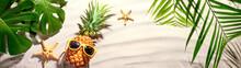 Pineapple With Sunglasses On Sand Beach