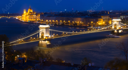 Night view on Patliament and Chain Bridge in hungarian city Budapest outdoors.