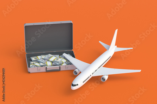 Tela Suitcase full of banknotes near passenger airplane