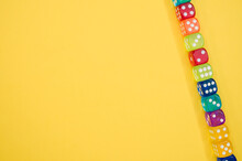 Dice In A Row Isolated On A Yellobackground
