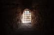 Leinwandbild Motiv Window with bars in the old fortress