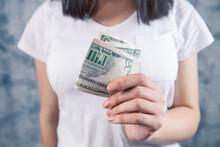 Girl Holding  Money In Her Hands