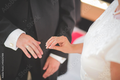 Canvas Bride and the groom exchanging rings at the wedding ceremony