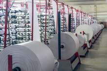 Making Rolls Of White Polypropylene Fabric On A Loom
