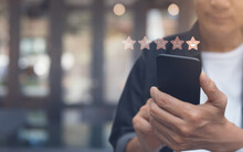 Man Hand Using Mobile Phone With Icon Five Star Symbol To Increase Rating Of Company, Customer Service Concept