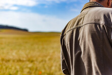 Madrid Spain. May 26, 2021. Dorsal View Of The Back Of A Middle-aged Man With Sunny Wheat Field In The Background