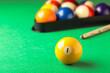Leinwandbild Motiv Billiard ball with number 1 on green table, space for text
