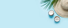 Women's Hat With Wide Brim, Sunglasses, Coconut And A Branch Of A Palm Tree On A Blue Background. Summer Concept, Vacation At Sea. Banner. Flat Lay, Top View