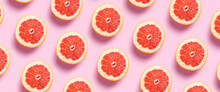 Half Grapefruit On A Pink Background. Pattern. Banner. Flat Lay, Top View