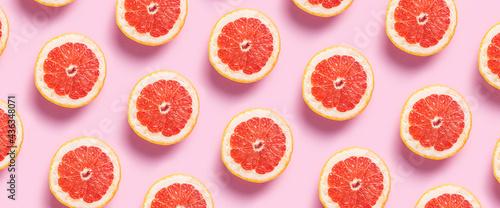 Canvastavla Half grapefruit on a pink background