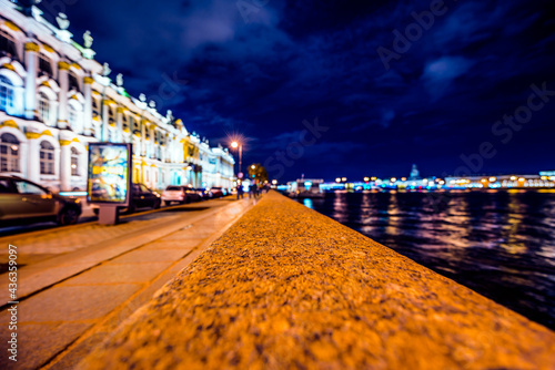 Fotografiet Lights of the city at night, view of the city from the level of the embankment o