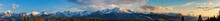 A Beautiful Panorama Of The Entire Range Of The Tatra Mountains. The Colorful Rays Of The Sun Illuminate The Snow-covered, White Mountains. The View At Sunrise. Poland