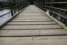 Wooden Bridge In A Pond