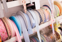 Colorful Ribbons, Webbing, Braid, Bias Tapes, Cords For Sewing Or Needlecraft On Store Showcase