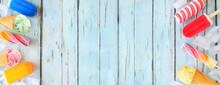 Assorted Colorful Summer Ice Pops And Ice Cream Treats. Top View Double Border On A Rustic Blue Wood Banner Background. Copy Space.