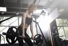 Sportswoman Lifting Weights At Functional Training Gym