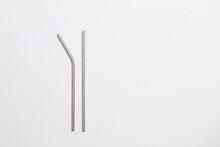 Metal Straws On A Plain White Background
