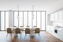 Modern White And Beige Kitchen And Dining Room Interior