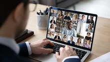 Businessman Talking To Team Of Colleagues On Online Video Conference Call On Laptop. Screen View Of Coach, Teacher And Students Attending Webinar. Distance Business Meeting, Remote Work Concept