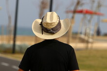 A Man On Vacation On The Shores Of The Mediterranean Sea In Northern Israel. Hot Summer Day.