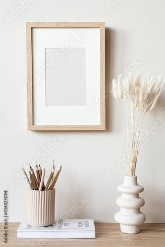 Fotografie, Obraz Vertical frame mockup standing on wooden floor in living room interior with tassels on white wall background