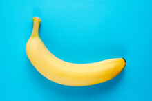 Simple Healthy Food Flatlay With A Fresh Banana On Blue Background