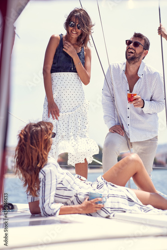 Group of classy rich friends cruising together; Luxurious lifestyle concept #436444633