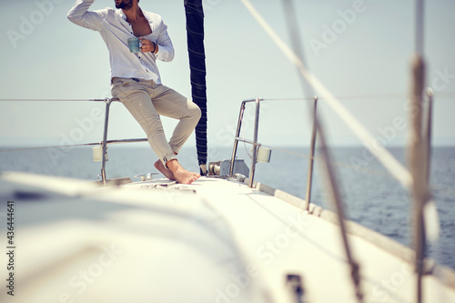 Casual handome man sailing alone; Luxurious lifestyle concept #436444641