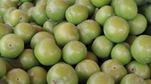Close-up Green Plum Fruits N The Fruit Market. Group Of Fresh Green Plums Background On The Market Stand.