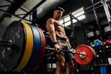 Weightlifting And The Concept Of Sports Life. A Half-naked Man Stands In The Middle Of The Gym And Raises A Barbell With Weight Plates. Dead Lift With High Load. Strength And Energy, Bodybuilding