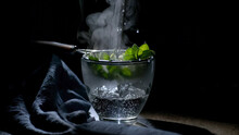 Steeping Fresh Mint With Boiling Water In A Cup
