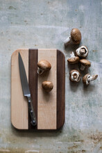 Cutting Board With Mushrooms And Knife