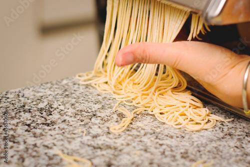 Fotografiet Homemade fresh pasta, traditional italian cuisine. Close up.