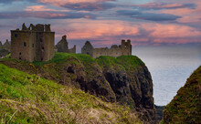 """Ruins Of Dunnottar Castle, Near Stonehaven, Aberdeenshire, Scotland, UK. Dunnottar Castle, """"fort On The Shelving Slope"""") Is A Ruined Medieval Fortress Located Upon A Rocky Headland On The Northeastern"""