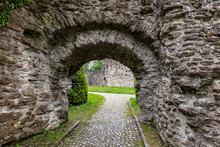 Old Stone Arch In The Garden, Stone Walls Of A Castle