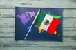 Leinwandbild Motiv Mexican flag and world map on color wooden background