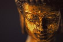 Close Up Of A Buddha Figurine